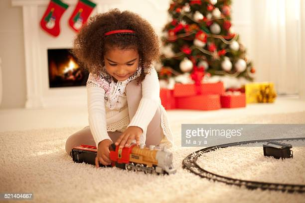 Cute girl enjoy playing with new toy