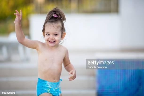 Cute girl enjoying sand on the beach