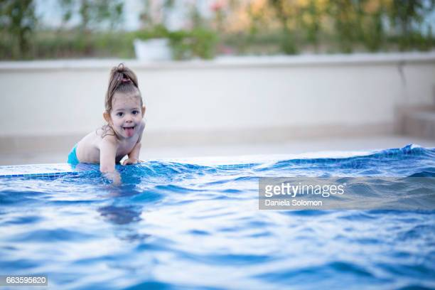 cute girl enjoying water in the swiming pool - 2 girls 1 sandbox stock photos and pictures