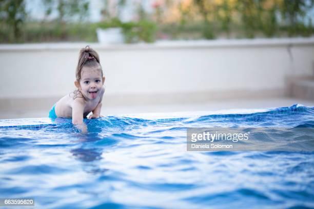 Cute girl enjoying water in the swiming pool