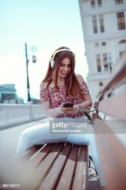 cute girl establishing video conference and sending selfie from smartphone - legs spread woman stock photos and pictures