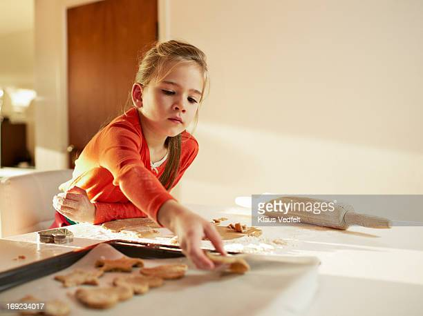 Cute girl getting ready to bake cookies