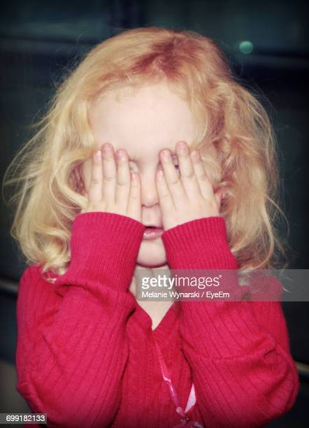 Cute Girl Hiding Face With Her Hands