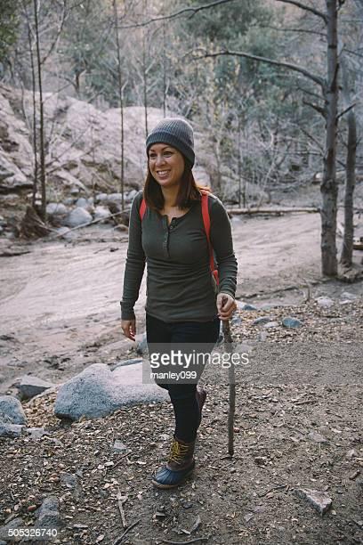 cute girl hiking in mountain trail