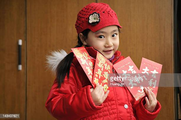 Cute girl holding hongbao for Chinese New Year