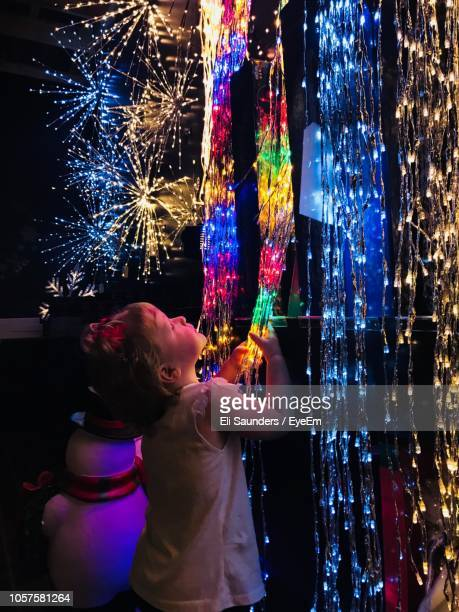 cute girl holding illuminated christmas lights - pigeon forge stock pictures, royalty-free photos & images