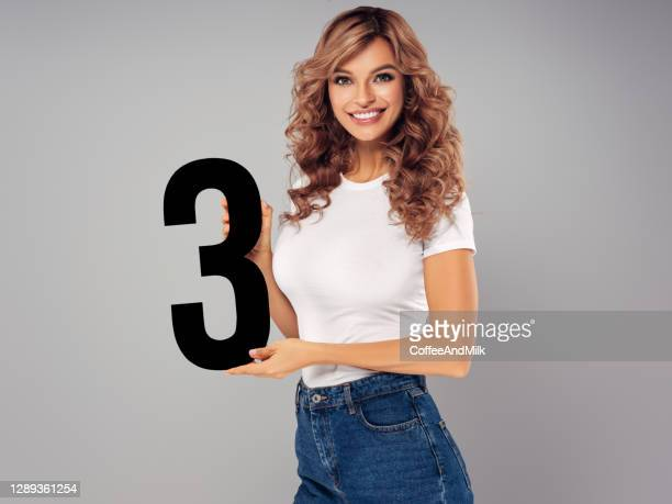 cute girl holds holding artificial number three - number 3 stock pictures, royalty-free photos & images