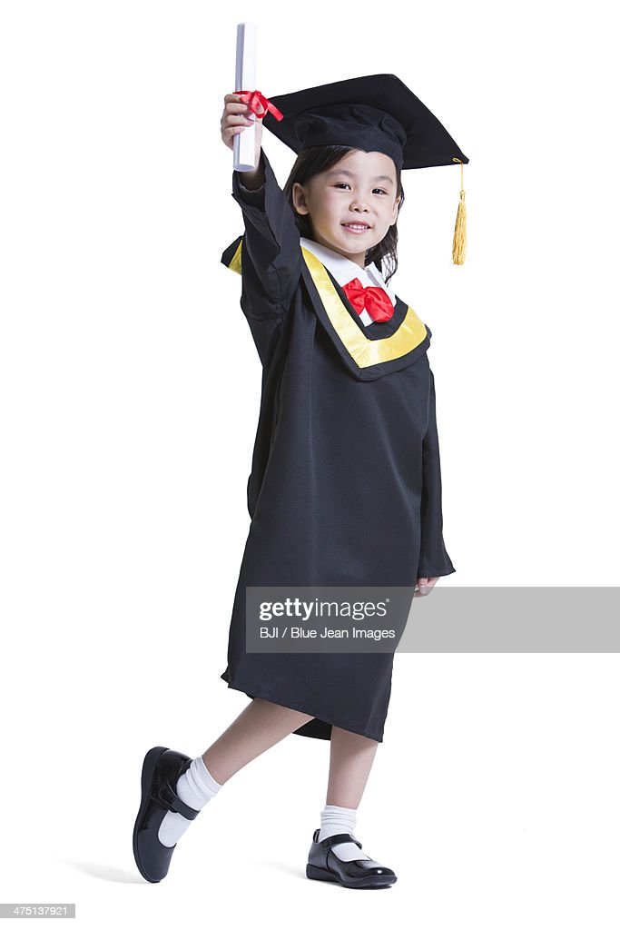 Cute Girl In Graduation Gown Stock Photo | Getty Images