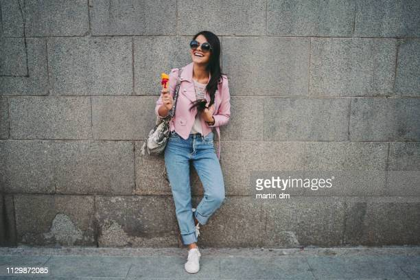cute girl in the city eating ice-cream - fashionable stock pictures, royalty-free photos & images