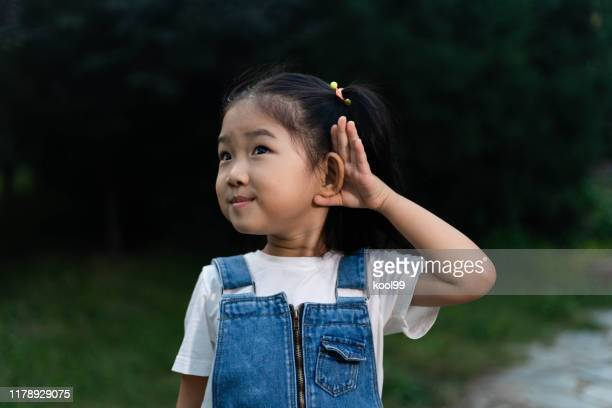 cute girl listening - listening stock pictures, royalty-free photos & images