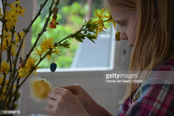 Cute Girl Looking At Plants In Home