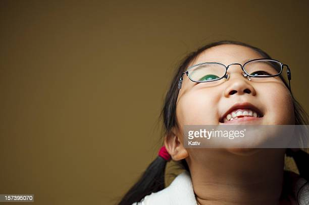 cute girl looking up and smiling - small faces stock pictures, royalty-free photos & images