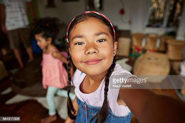 cute girl making selfie in living room - selfie stock pictures, royalty-free photos & images