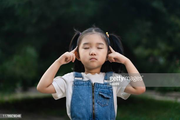 cute girl meditating - ncaa stock pictures, royalty-free photos & images