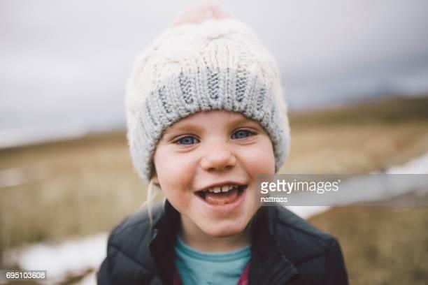 Cute Girl playing on a winter walk