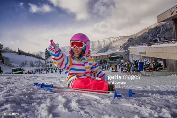 cute girl playing ski - スキー板 ストックフォトと画像