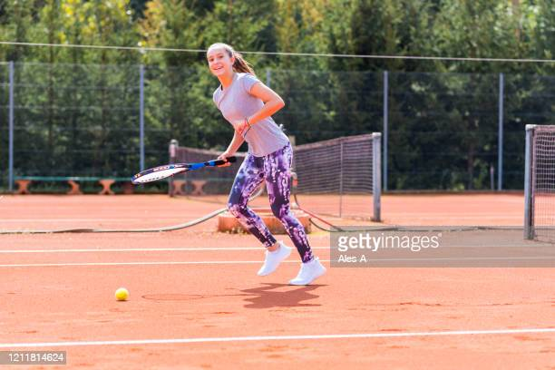 cute girl playing tennis - tennis racquet stock pictures, royalty-free photos & images