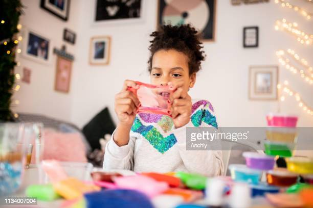 cute girl playing with slime - slimy stock pictures, royalty-free photos & images