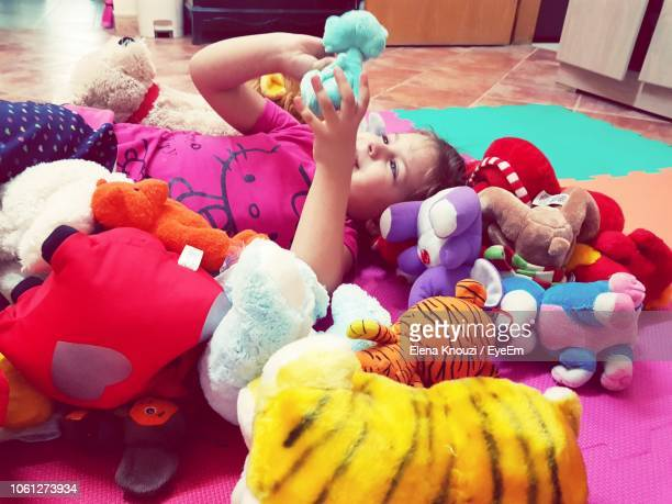cute girl playing with toys at home - elena knouzi stock pictures, royalty-free photos & images