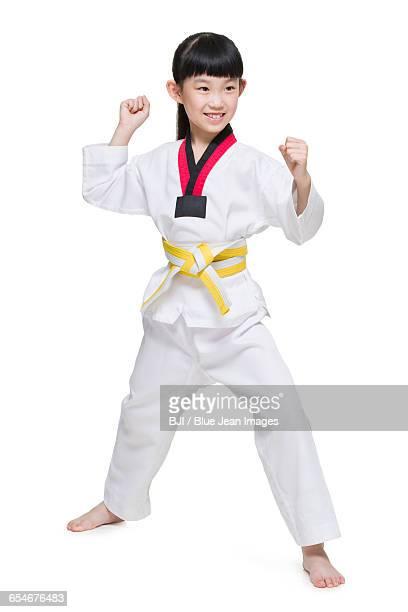 Cute girl practicing Tae Kwon Do