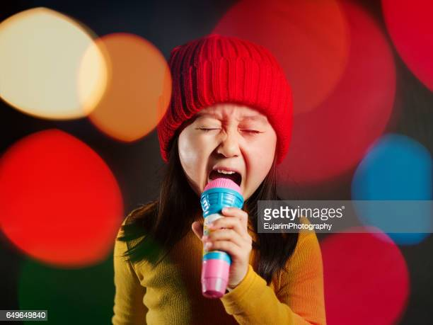 Cute girl singing like a rockstar