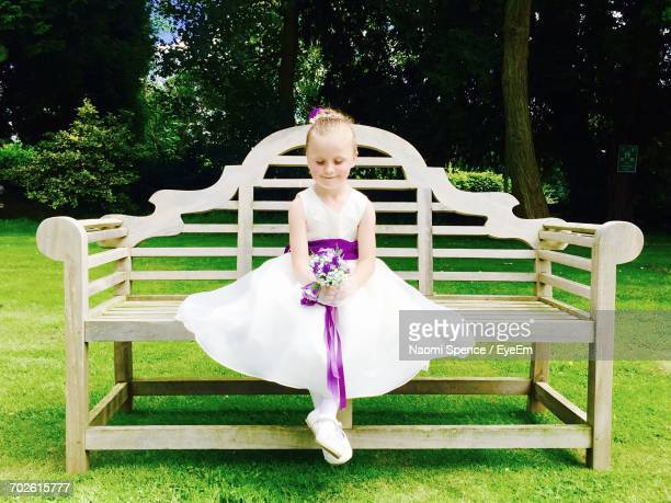 Cute Girl Sitting On Bench In Park