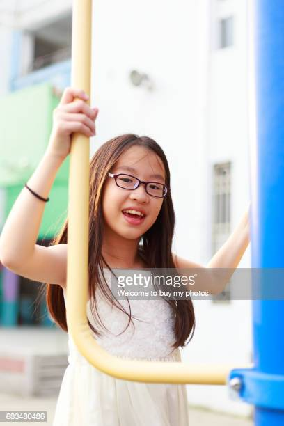 Cute girl spent a good time in the schoolyard.