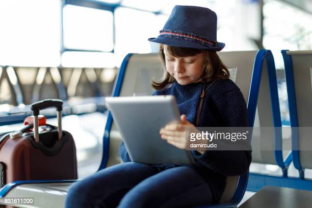 Cute girl  waiting for the plane