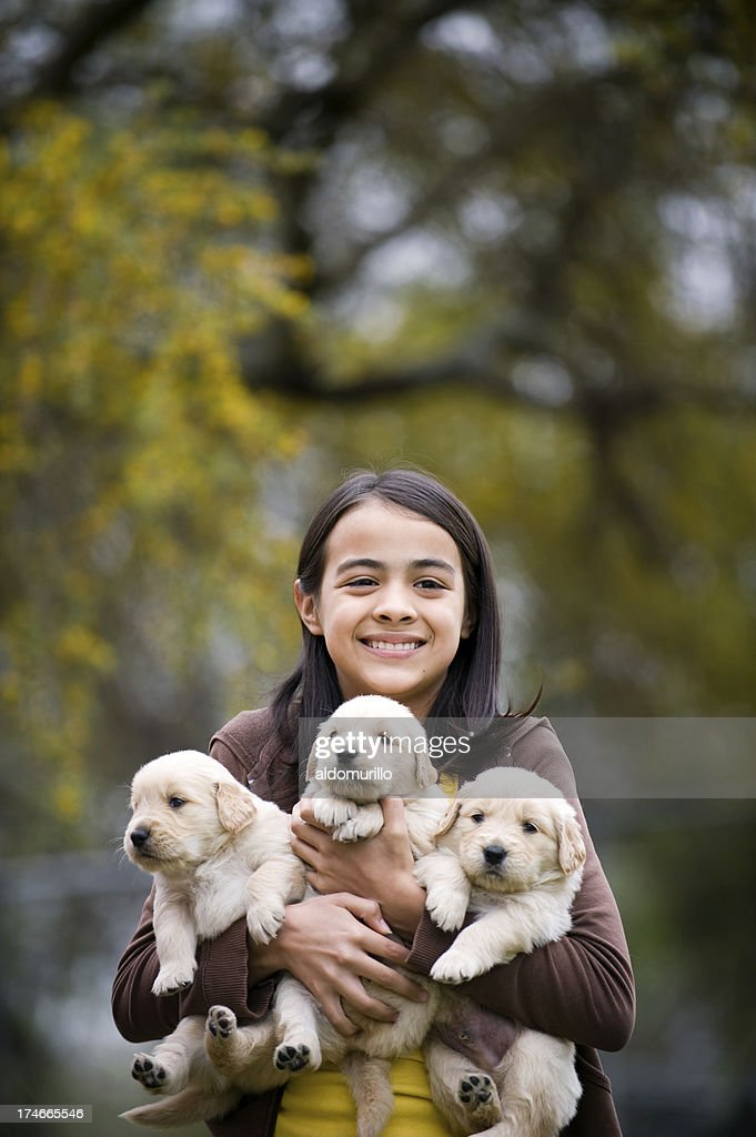 Cute girl whit her puppies : Stock Photo