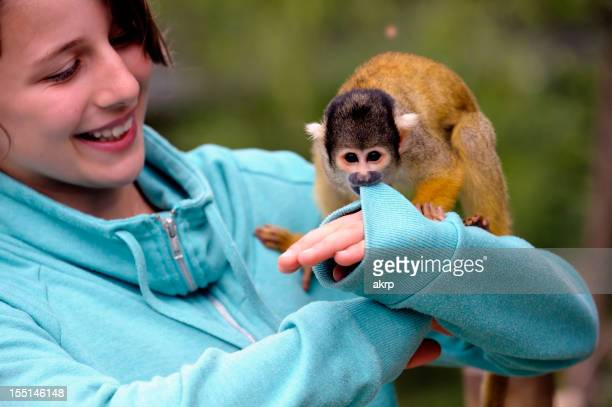 Cute Girl with a Squirrel Monkey