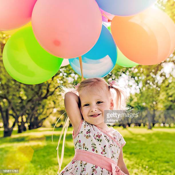 Cute girl with balloons