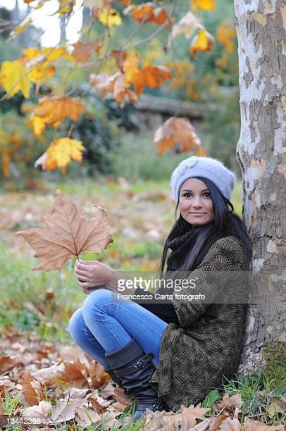 Cute girl with big dry leaf