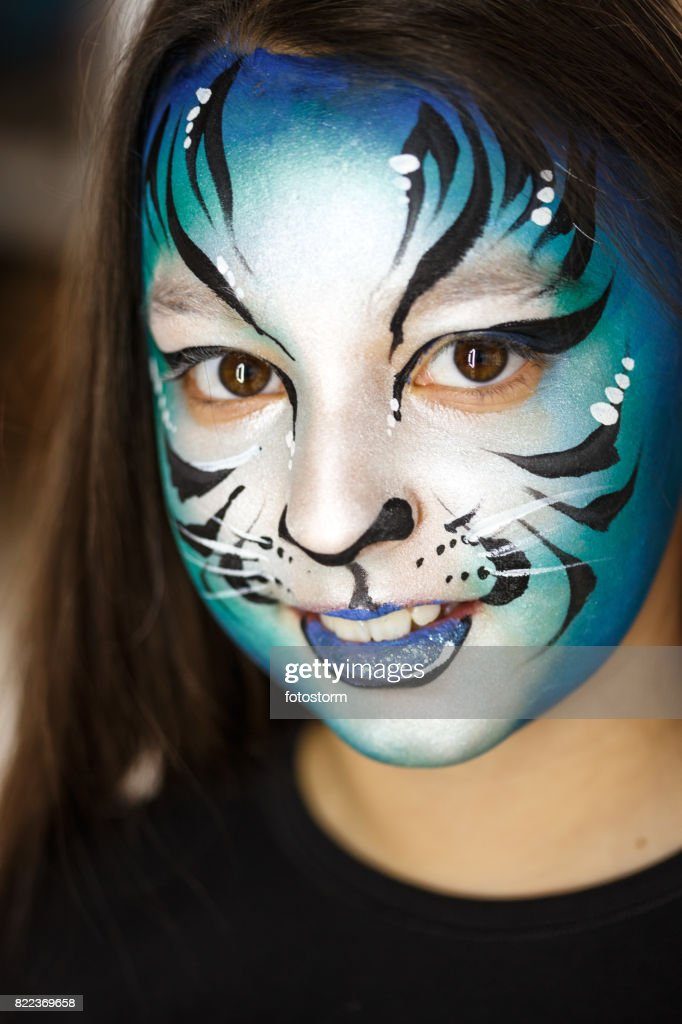 Cute girl with face paint : Stock Photo