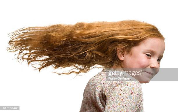 Cute girl with fluttering hair