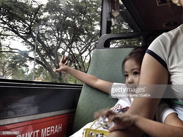Cute Girl With Mother Travelling In Bus