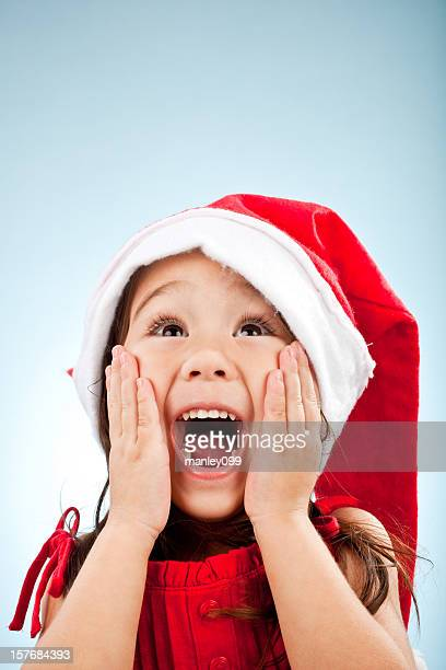 cute girl with santa hat surprise - santa face stock pictures, royalty-free photos & images