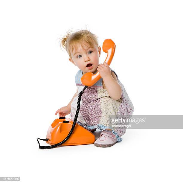 Cute girl with telephone. Child Baby People Toddler Phone