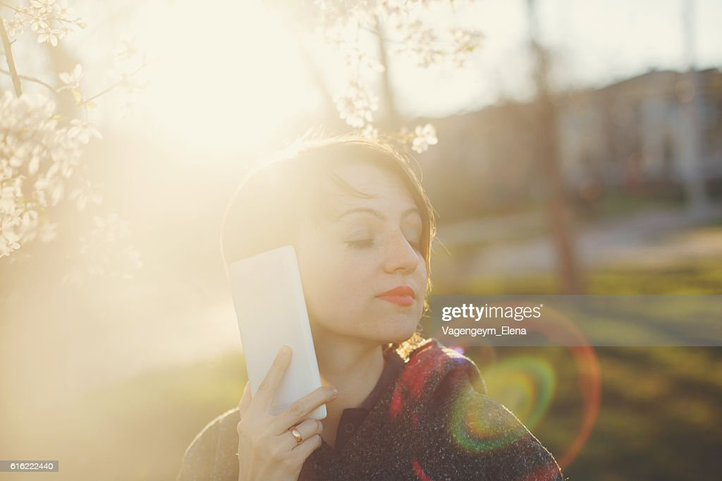 Cute girl with the phone. : Stockfoto