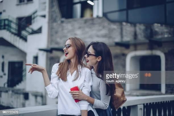 Cute girlfriends smiling