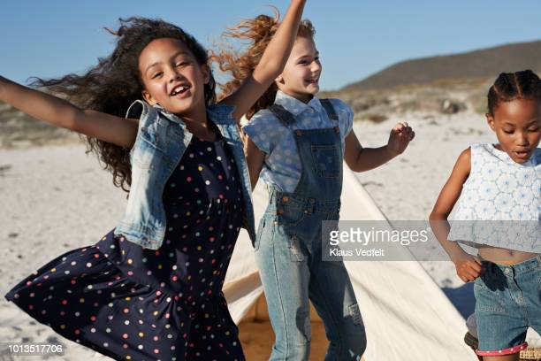 cute girls laughing & dancing together on the beach - only girls stock pictures, royalty-free photos & images