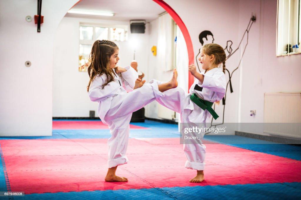 Cute girls on Taekwondo training : Stock Photo