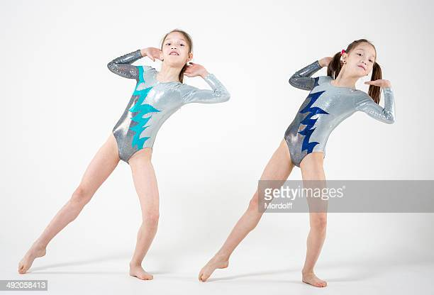 cute gymnasts sisters-twins - leotard stock photos and pictures