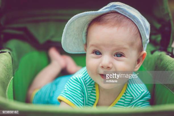 Cute happy baby boy in carriage
