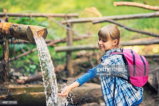 cute hiker drinking water from moutain stream - zakopane stock pictures, royalty-free photos & images