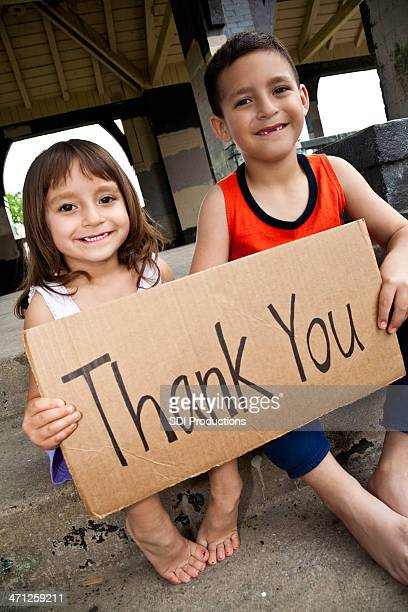 """cute hispanic children holding """"""""thank you"""""""" sign - thank you phrase stock pictures, royalty-free photos & images"""