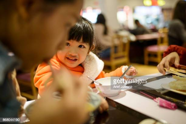 Cute japanese girl have lunch with mom