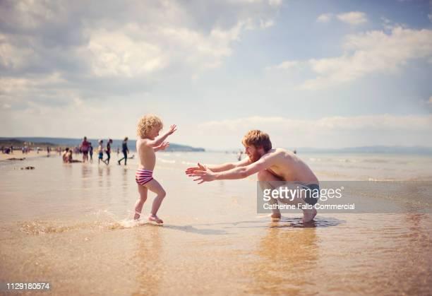 Cute Kid running to Dad