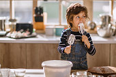 Cute Kid Tasting Whipped Cream of Egg Beater
