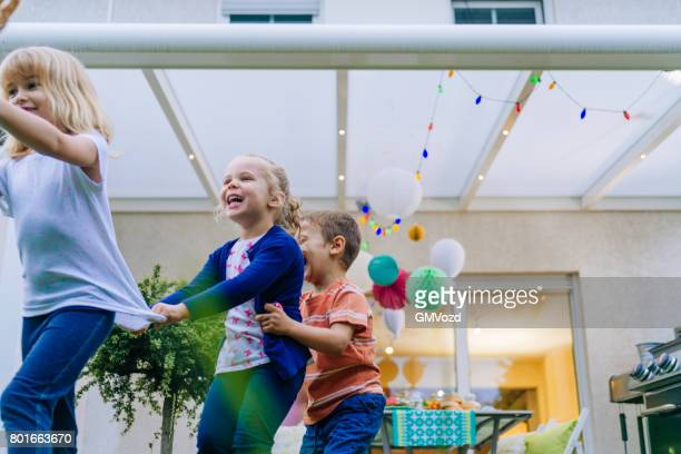 Cute Kids Having Fun Outside for Summer Backyard Party