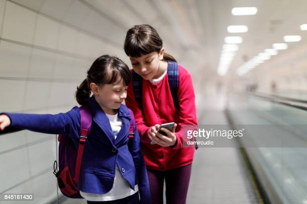 Cute kids in Instanbul travelling on escalator
